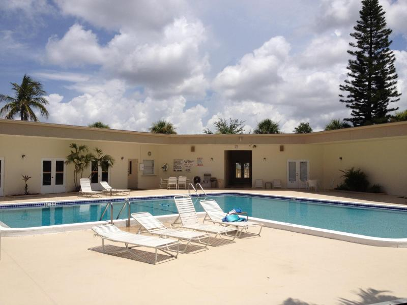 pool area with fitness room and clubhouse