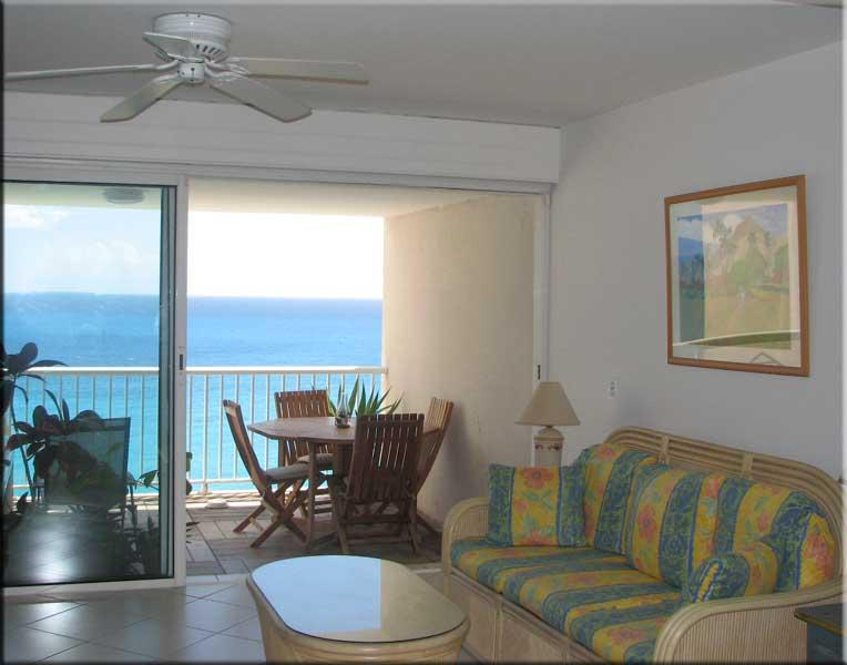 Living room with foldout couch looking out to the Caribbean balcony