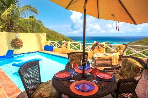 Enjoy your tropical meals out here under the canopy umbrella , cooled by a great sea breeze