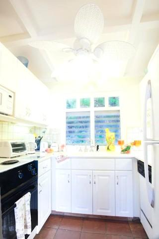 Kitchen has all utensils, coffee maker, microwave, toaster oven, stove, fridge/freezer, dishwasher