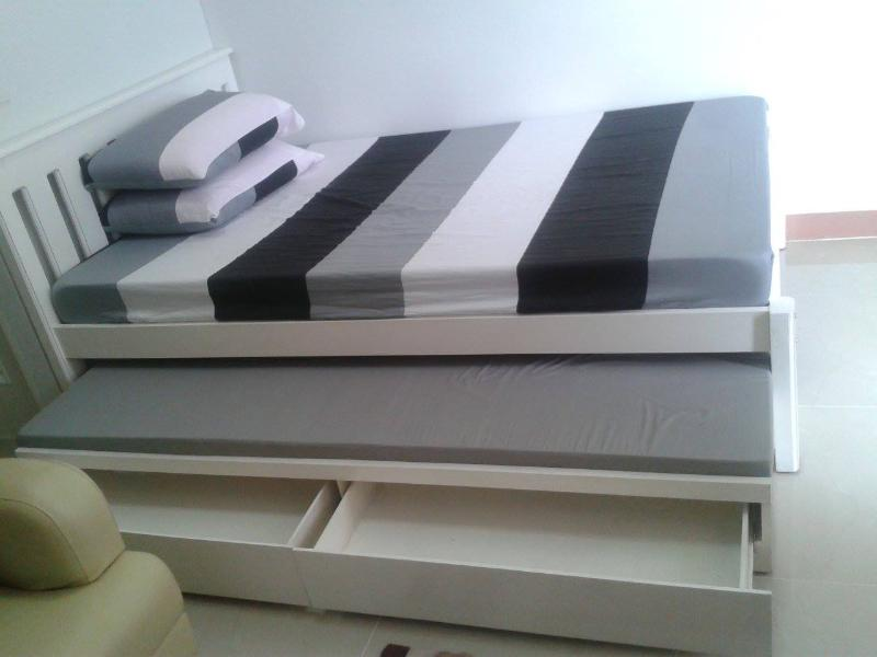 Double bed with pull out