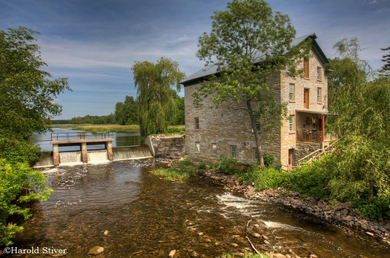 The Island Mill Getaway in the historic Lonsdale Grist Mill on an island in the Salmon River