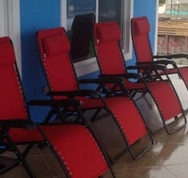 Gravity Loungers on screened porch
