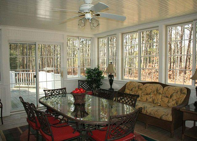 Sun Porch off of kitchen, opens to deck
