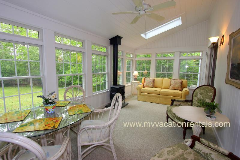 Sun Porch off of Living Room Opens to Deck Dining and Private Back Yard