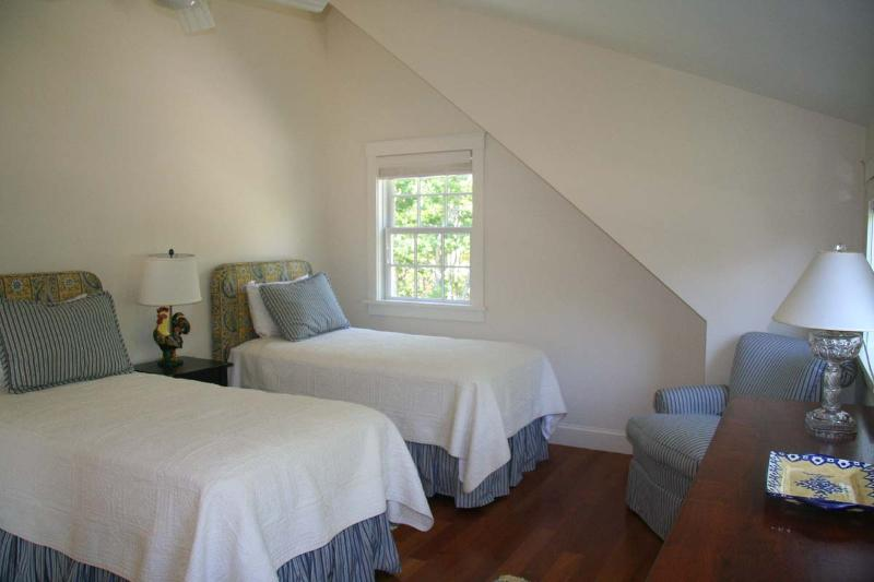 Detached carriage house guest bedroom