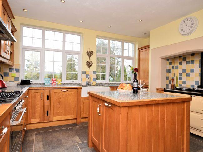 Kitchen with Aga and garden views