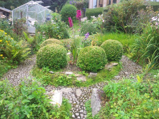 Part of the beautiful enclosed cottage style garden