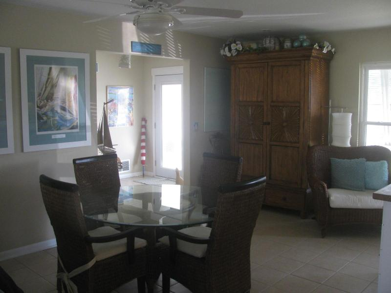 Dining room with wine cabinet, table seats 6. with ceiling fan.