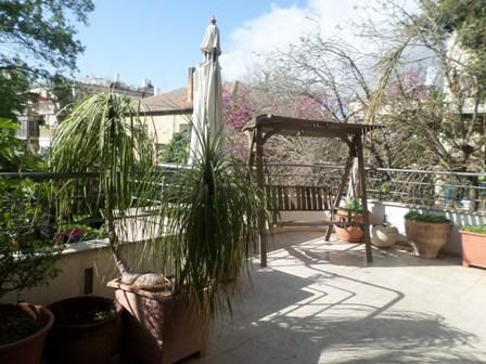 Beautiful large balcony with wooden swing seat. Perfect for enjoying your morning coffee!