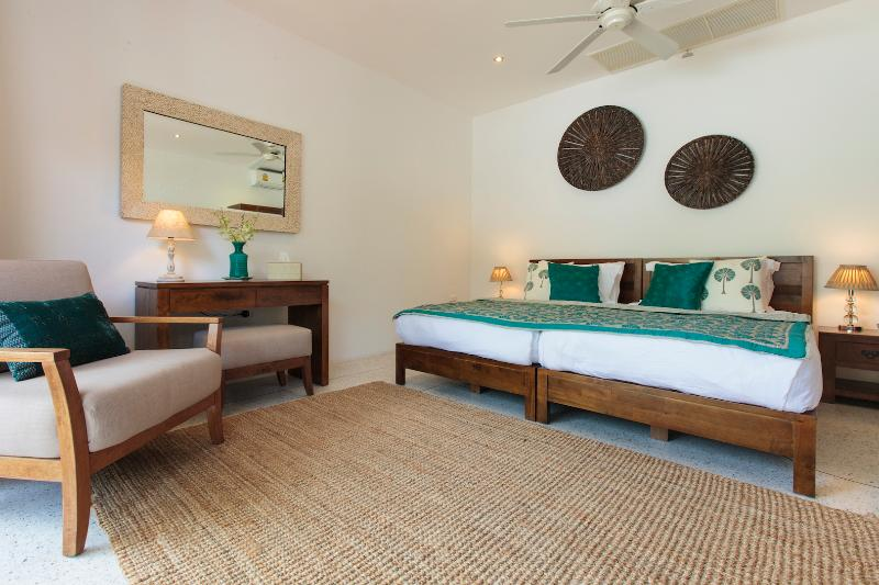 Superking or super single  twin beds, ensuite rain shower & bathroom. New aircon & ceiling fan.
