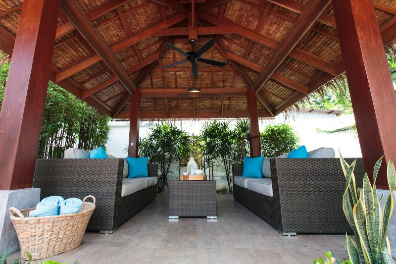Thai Sala with ceiling fan and comfortable sofas to lounge in the tropical garden