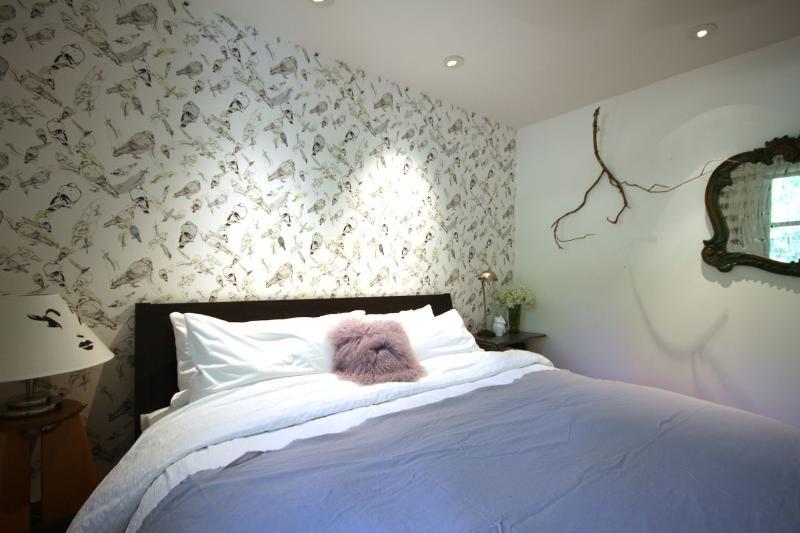 Cottage bedroom. King size bed.