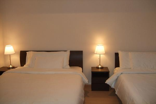bed room with 1 double bed and 1 single bed