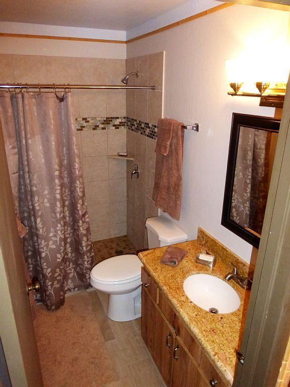 New walk-in tiled shower
