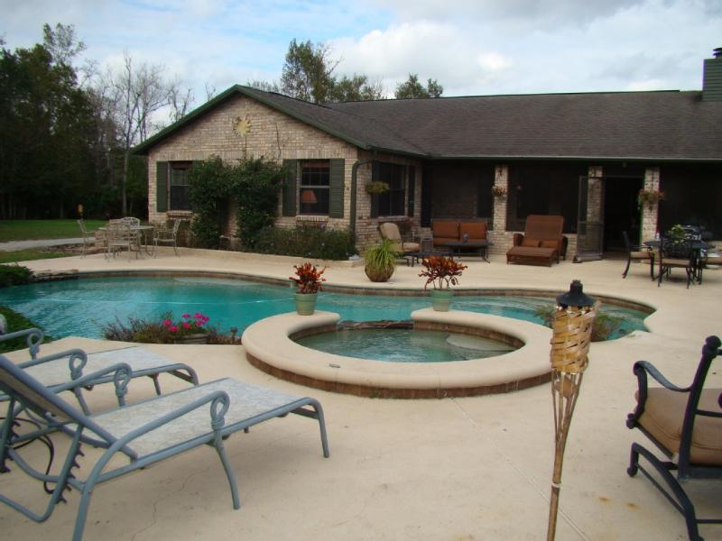 Beautifully landscaped pool and hot tub for lounging and gathering.