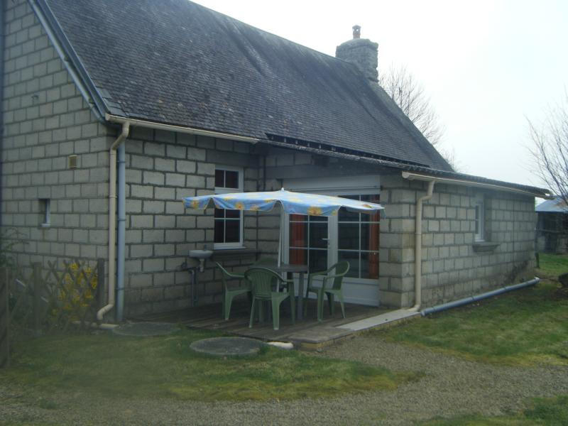 Rear view of cottage with brekfast patio