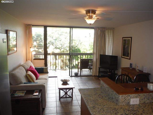 Open floor plan - kitchen and living room both look out to the lanai. Queen size sleeper couch