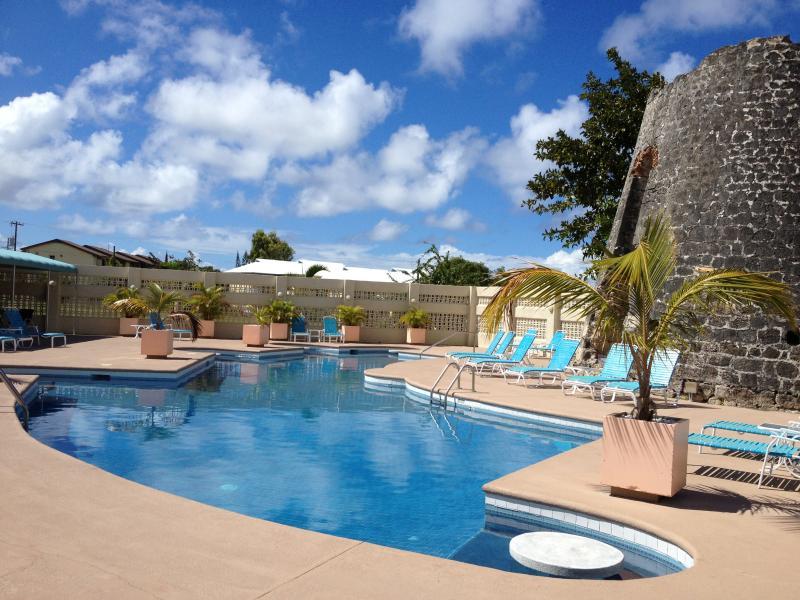 sugar beach pool with historic sugar mill