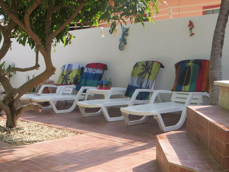 Relaxation area with cool Aruba Balashi beers and cocktails great while relaxing at the pool