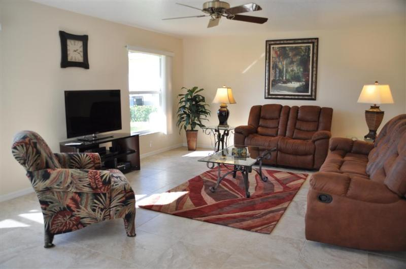 Spacious, bright family room with 46' Smart TV, Blu-ray DVD and surround sound