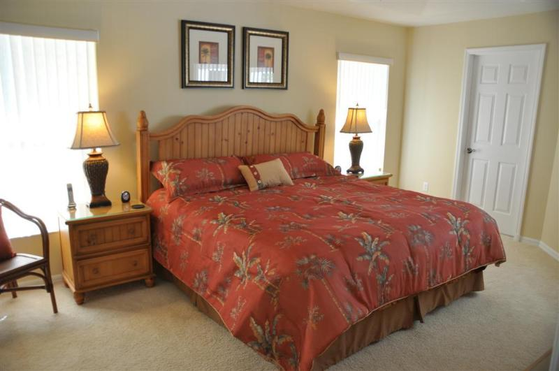 Tastefully furnished master bedroom with king size bed and bedroom set