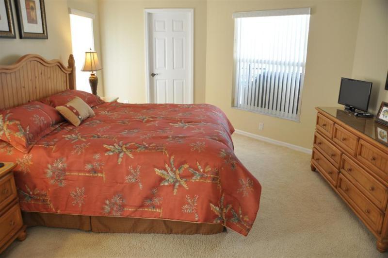 Master bedroom showing access door to pool bathroom and pool deck