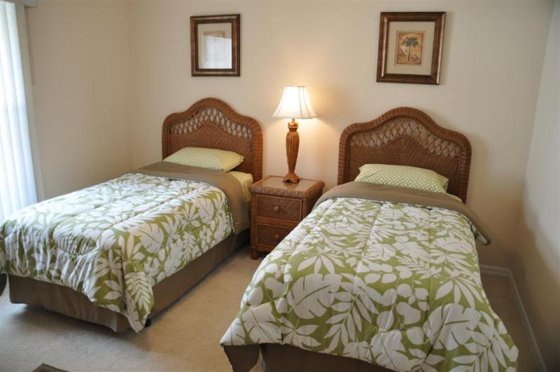Spacious twin bedroom with walk in closet