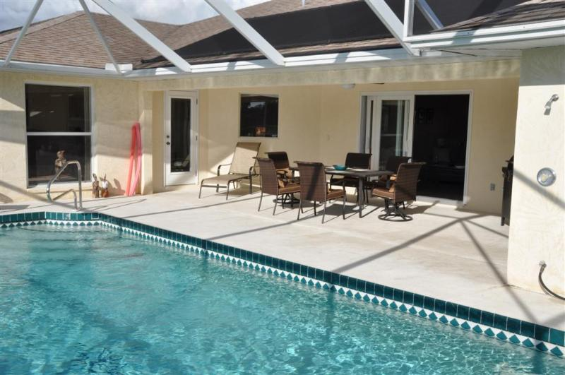 Spacious west facing lanai with large gas barbecue ideal for outdoor living