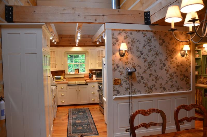 Dining/kitchen---vaulted celing, skylights, french doors into screened porch.