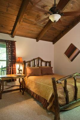 Queen Bed, Hand Crafted from Dogwood, in the Master Bedroom, Large Closet, Ceiling Fan, & Radio.