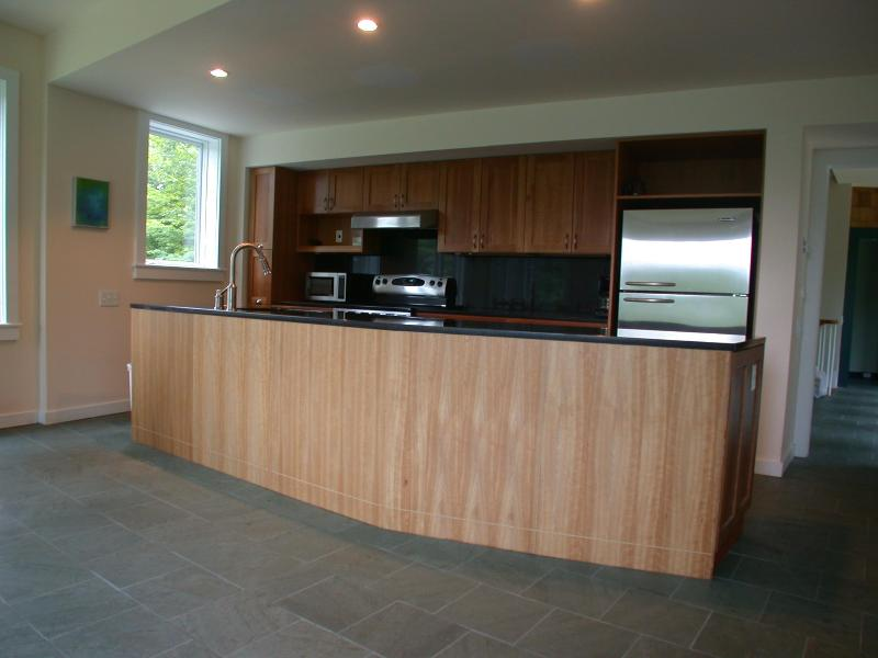 Gourmet Granite, Cherry, and Stainless Steel Kitchen