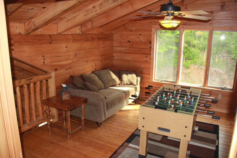 loft has a foos ball table as well as a quiet comfy couch for reading.