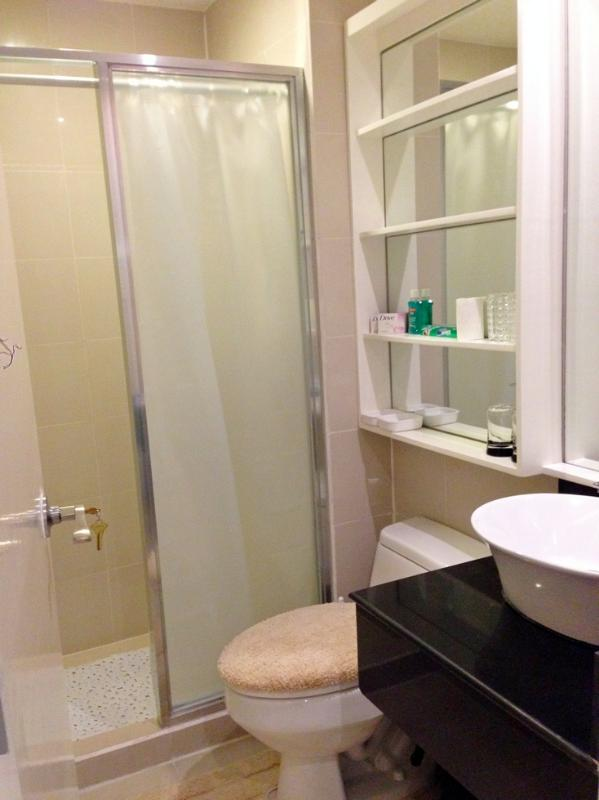 Semi-enclosed shower area with shower curtain