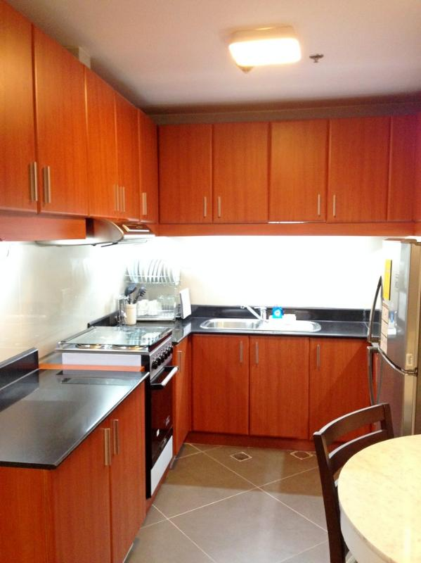 Kitchen complete with cabinets and shelves