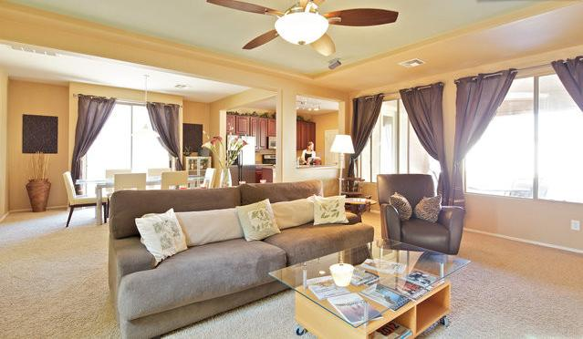 Spacious family room great for relaxing and conversation. Sofa is equivalent to a twin size bed.