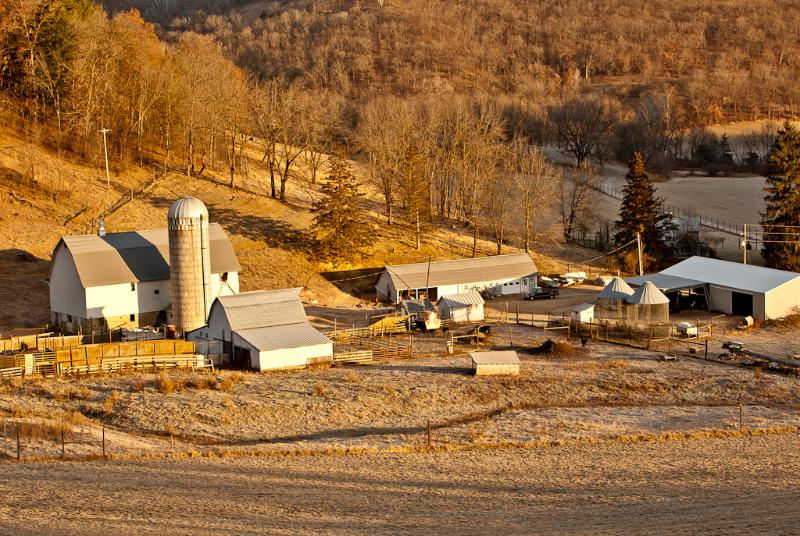 The barn and outbuildings as seen from one of the surrounding bluffs in late fall.