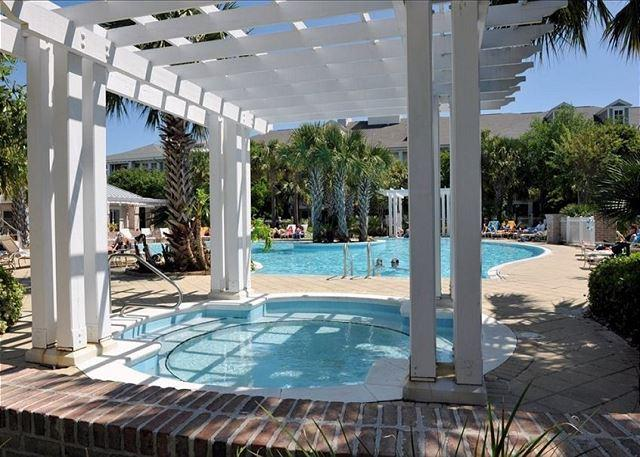 The shared pool for Le Jardin with a kids pool and hot tub