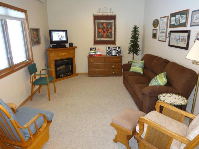 Living Room with Recliner coach and Dish TV!