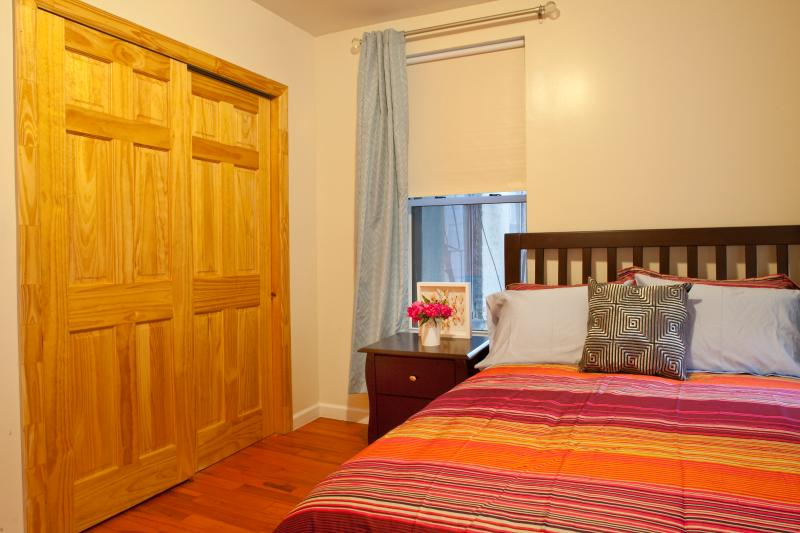 Bedroom 2Hardwood bed frame with bedside table; large closet with sliding doors.  3 windows!