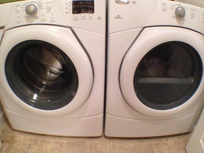 New, full-sized washer and dryer