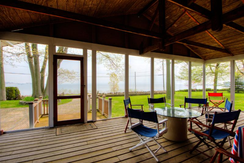 The screened in porch has fantastic views and sounds of the lake