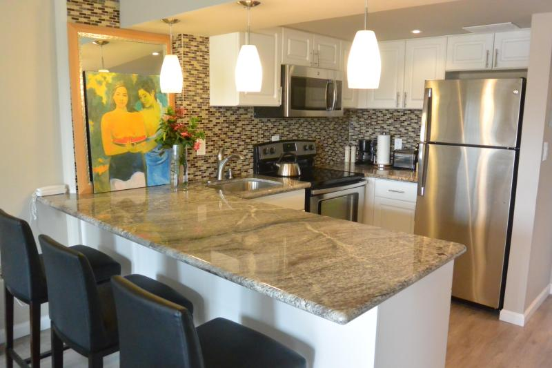 Your Gorgeous Granite and Stainless Steel kitchen with glass tile backsplash