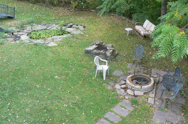 Stone fire pit and Koi pond