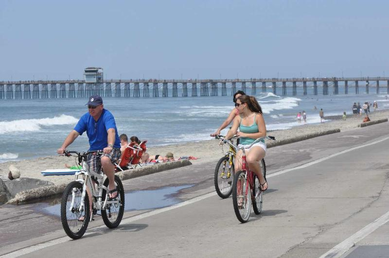 Biking along the Strand.  Rentals at the pier.