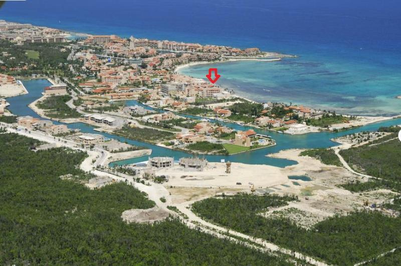 Aerial view of Puerto Aventuras with arrow showing location of the condo
