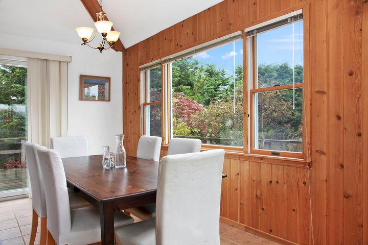 Dining area off the open kitchen, access to back deck with BBQ