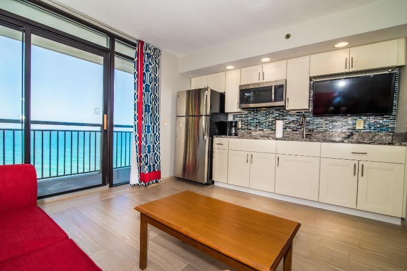 Enjoy the open kitchen/living room as you look out at the ocean and tropical pool area below.