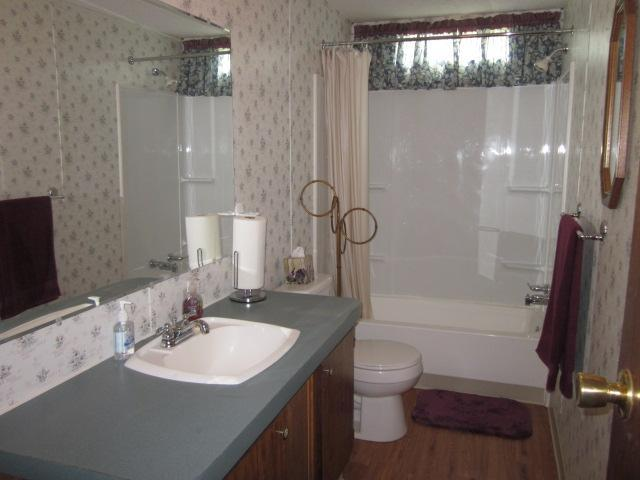 Second bath features a combined shower as well as tub