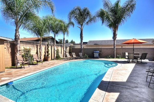 Sparkling Pool in tropical oasis! Patio seating, umbrella, lounge chairs for 14!  BBQ gas grill